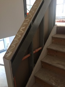 Stairwell - opened up to show sprinkler plumbing